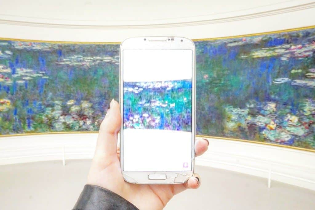 photo on a phone of monet's waterlilies