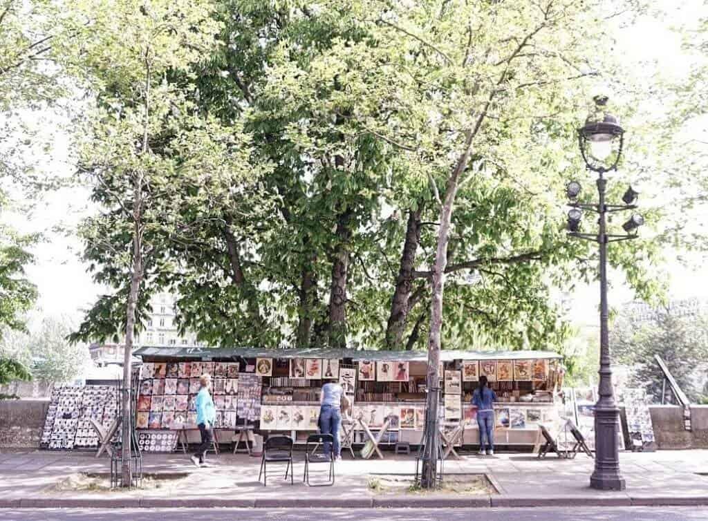 offbeat Paris destinations: wander along the seine and see the paris bouquinistes