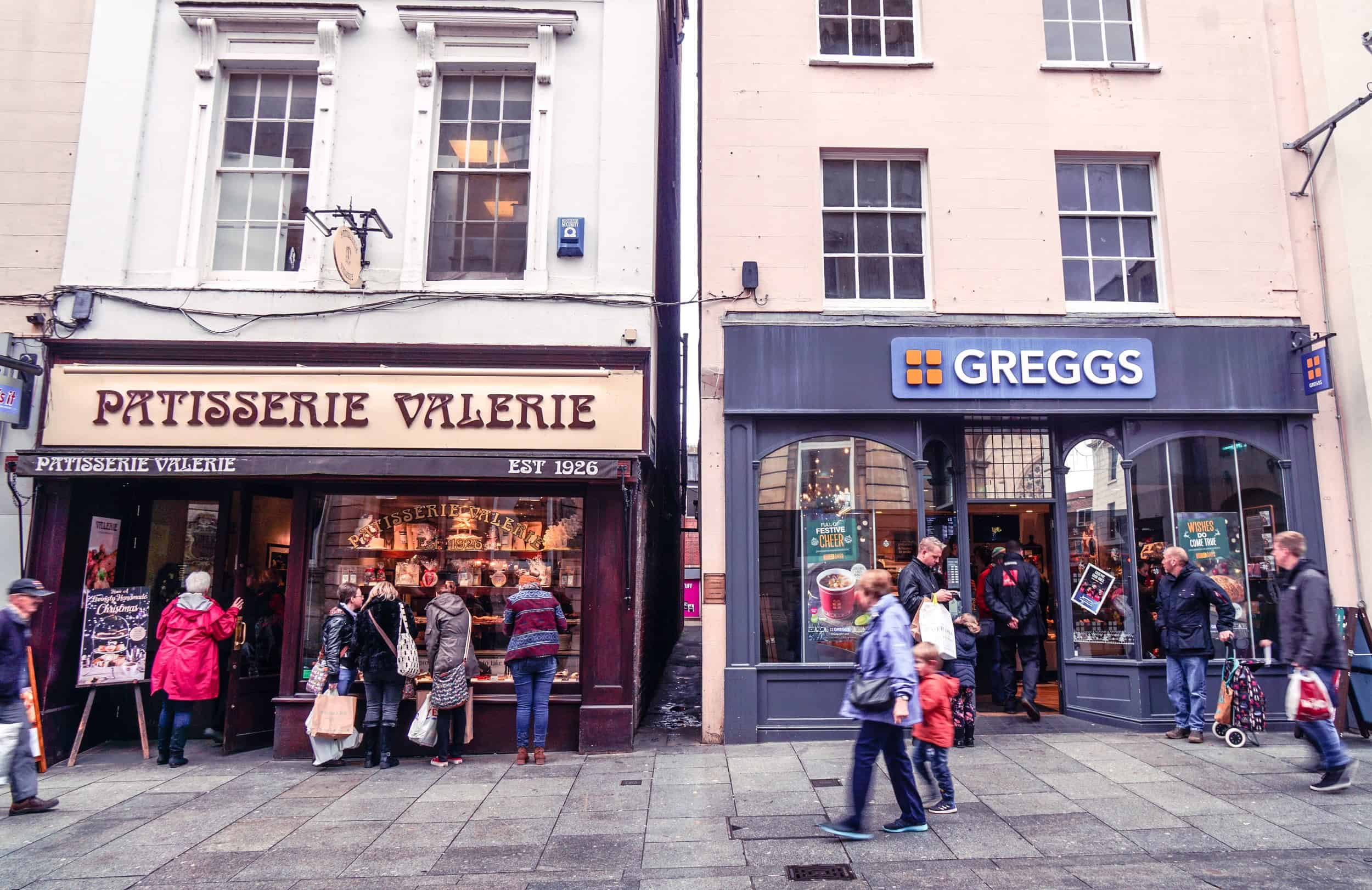Walking down parliament street in Exeter, Devon, England: thought by many to be the narrowest street in the world