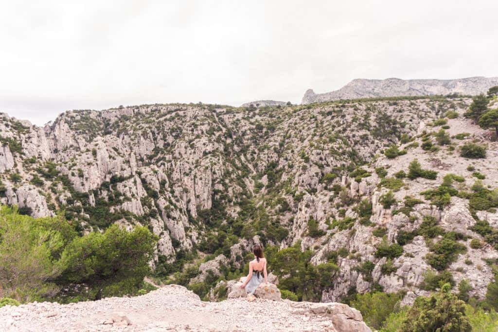 Adventure in Provence, Southern France: hiking the calanques de Cassis in a National Park: girl admiring the view