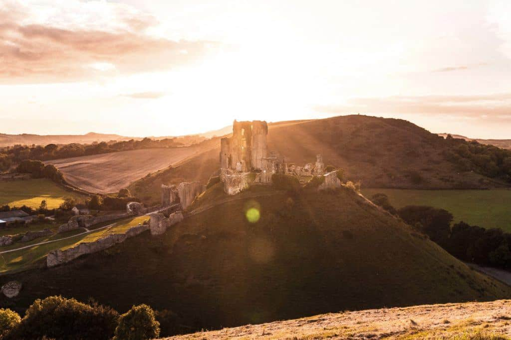 How to See Corfe Castle at Sunset, the Norman Fairytale Castle of Dorset, England