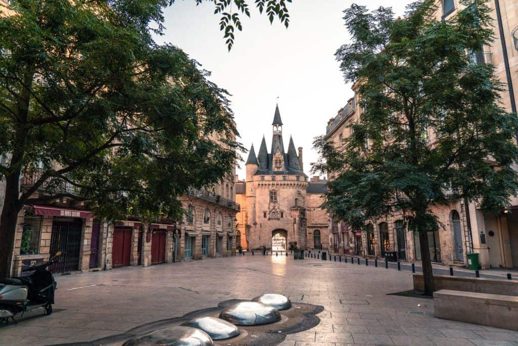 Sunrise at Porte Cailhau, A Girls Getaway Weekend in Bordeaux Itinerary. How to spend three days in Bordeaux; what to see, where to go, what to eat, and the best day trips from Bordeaux, South West France