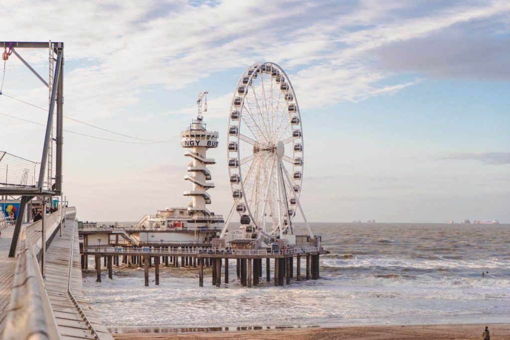 Riding the Ferris Wheel de Pier in Scheveningen at Sunset, The Hague, the Netherlands. Here's why you must visit the popular seaside resort of The Hague