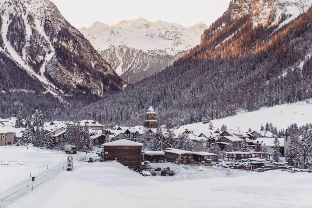 Bernina Express Review: A bucket list journey from Chur Switzerland to Tirano Italy on a UNESCO world heritage train ride.