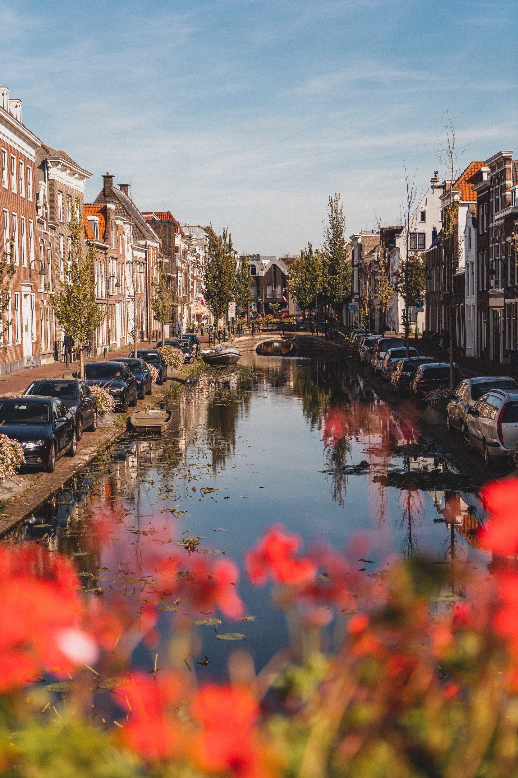 Here's why you need to visit Gouda, the cheese city of Holland, the Netherlands on your next Dutch adventure. How to visit the city of Gouda and what to do once there; admire the canals, enjoy the cheese culture, visit the town museum, and more!