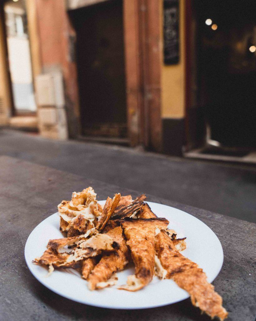 If you're looking for a traditional foodie experience on the Côte d'Azur then be sure to try the Socca in Nice. This savoury crêpe is Madde from chickpea flour and is ever so affordable. Here's where to find the best socca in Nice, Southern France