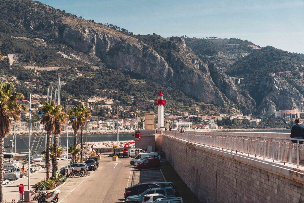 Menton lighthouse with mountains behind
