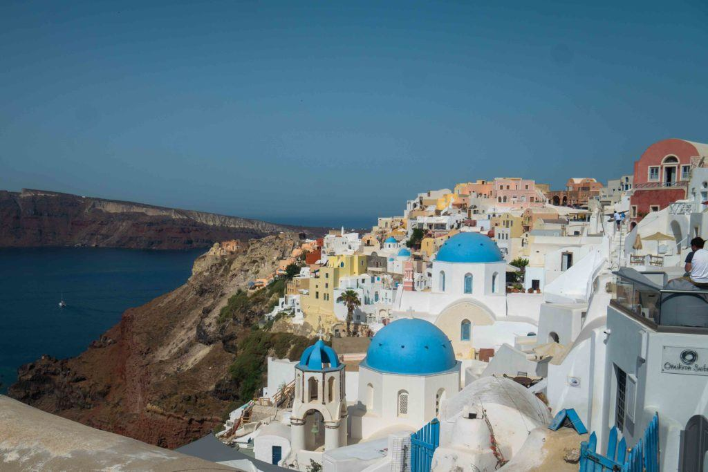 sunny day and domes of Santorini