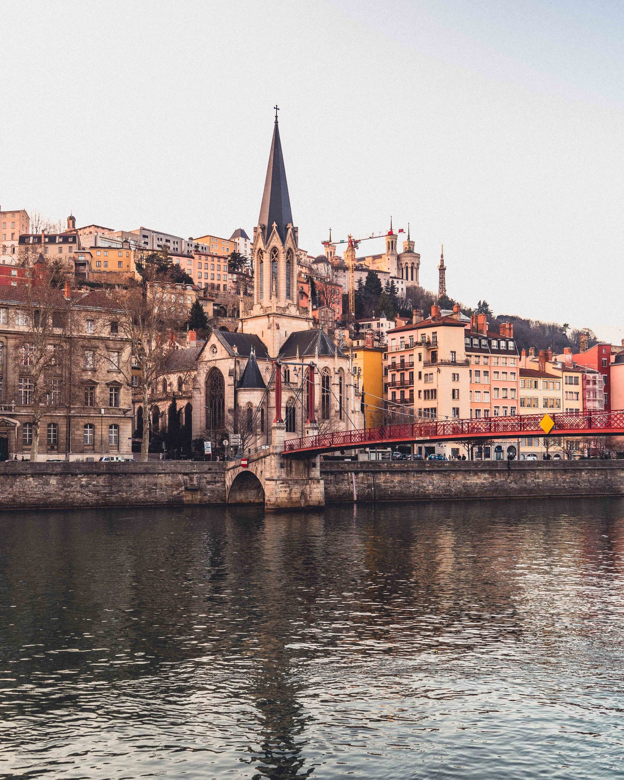 Here's why you need to visit Lyon in the East of France: reasons to go to the foodie capital of France, including murals, the fete des lumieres, architecture, and hidden gems!
