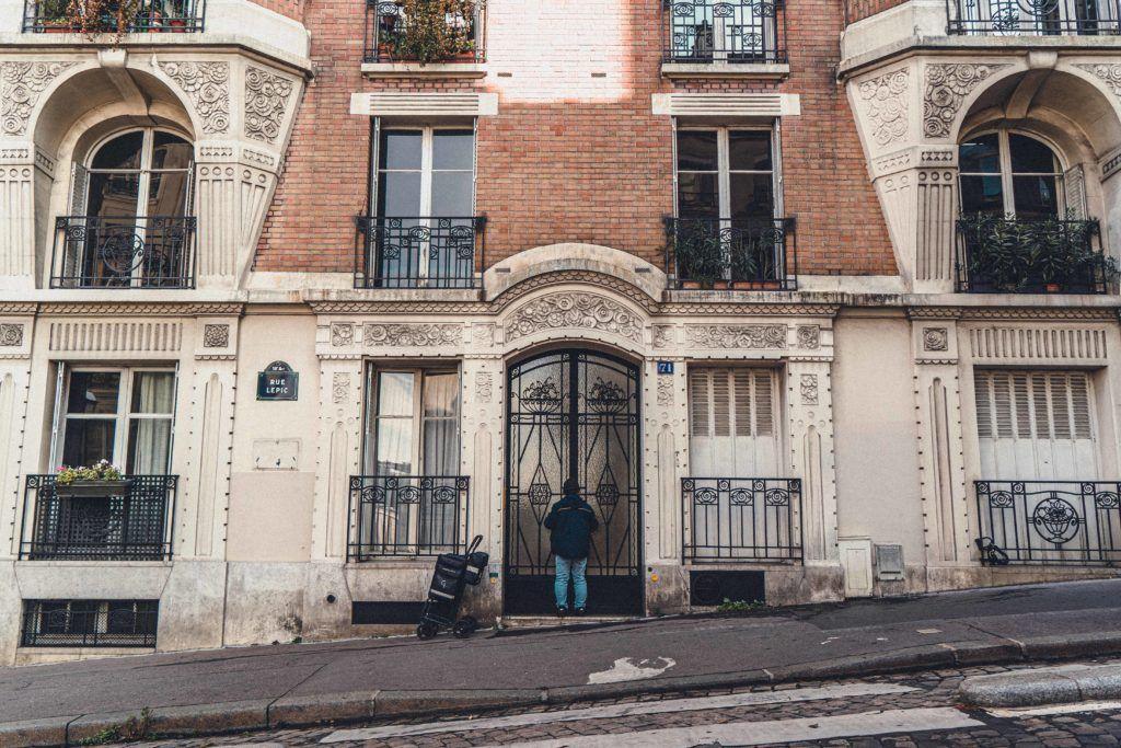 person standing in front of glass door in the 18th arrondissement of Paris, France