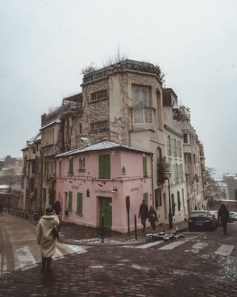 snow in paris - la maison rose in the snow, paris, france